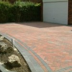 block paving with raised kerbs on a slope